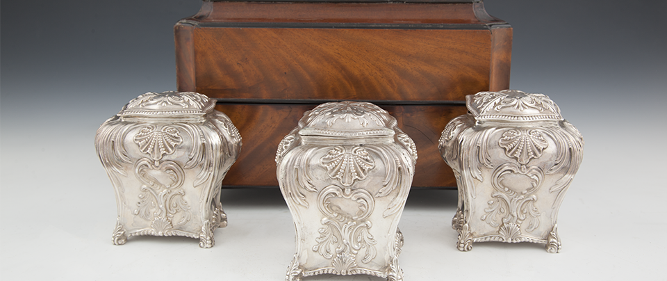 A SCOTTISH GEORGE III SET OF THREE SILVER TEA CADDIES Sold for  €3,600.
